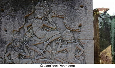 Engravings on a rock and temple - A medium shot of a rock...