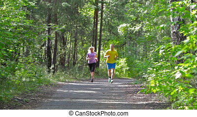 Enhancing endurance - Man and woman running in the park...