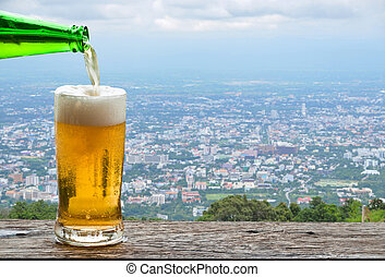 Enjoy beer with urban cityscape.