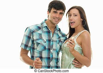 Enjoy Music Anywhere - Guy and girl enjoying music together