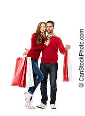 enjoy shopping - Happy young couple standing with a lot of...