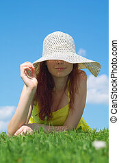 Enjoy summer time - A beautiful girl on yellow dress and hat...