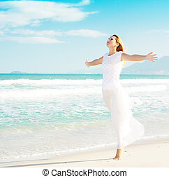 Enjoy sun - Young woman enjoy sun near ocean