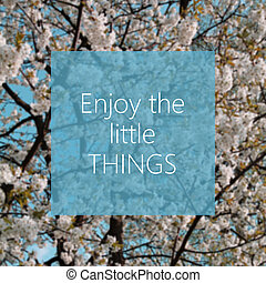 Enjoy the little things text with spring tree in the...