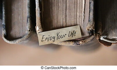 Enjoy your life quote, text and old books