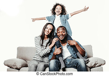 Enjoyed family triumphing on sofa