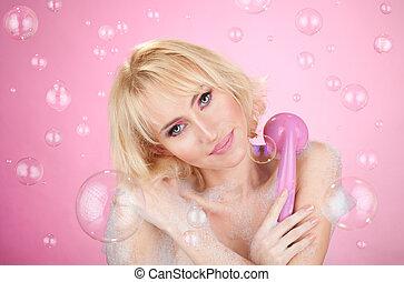 enjoying a shower - Beautiful happy young girl having a bath...