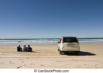 Enjoying Beach - Three people with their car enjoying beach...