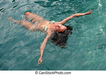 Enjoying  - Beautiful woman enjoying summer in the pool