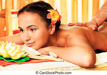 enjoying - Beautiful young woman taking spa treatments at...