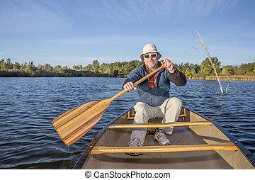 enjoying canoe paddling on lake