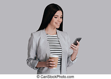 Enjoying coffee break. Gorgeous young woman in smart casual...