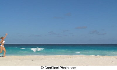 enjoying day on the beach slow motion