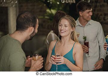 Enjoying Drinks In A Bar