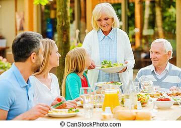 Enjoying family time. Happy family of five people enjoying...