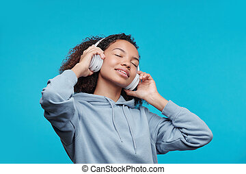 Enjoying favorite song - Content attractive African American...