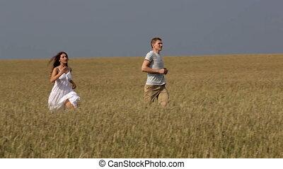 Enjoying freedom - Young couple enjoying freedom running...