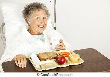 Enjoying Hospital Food - Senior hospital patient eating her ...