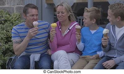 Enjoying Ice-cream - Family of four enjoying ice-cream...