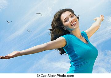 enjoying life - A beautiful girl enjoying summer sun