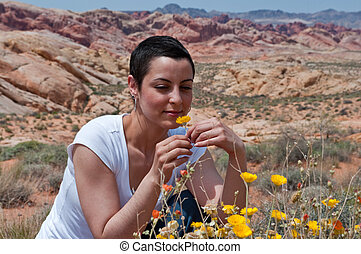 Breast cancer patient enjoying life again after chemo treatment ( wild flowers in the desert)