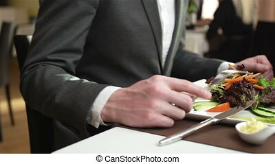 Enjoying Meal - Close-up of elegant people having a meal at...