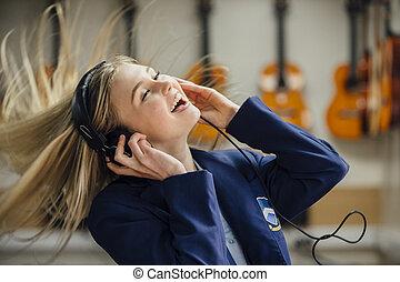 Enjoying Music At School - Teen student is enjoying...