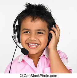 enjoying music with his headphones - an adorable asian boy...