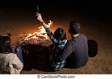 Enjoying Outdoor Fire At Night