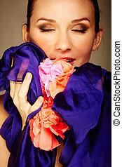 Enjoying senses - Gorgeous woman holds blue chiffon and...