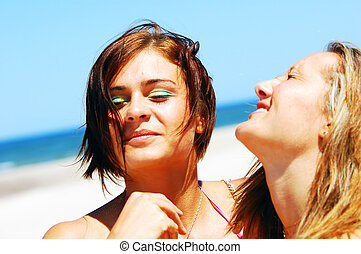 Enjoying summertime - Young attractive girls enjoying...