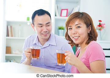 Enjoying tea/coffee