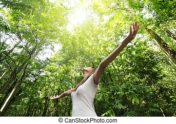 Enjoying the nature - Young woman arms raised enjoying the ...