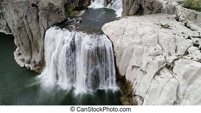 aerial view from a drone of the power that a waterfall has