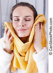Enjoying the softness of a towel - Woman enjoying the...