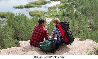 Enjoying the view - Hiking couple enjoying the picturesque...