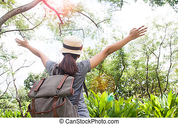 Enjoying travel, Young asian woman with backpack breathing...