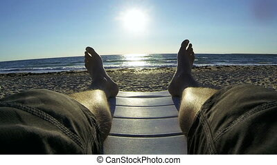Enjoying vacation on summer beach - Man enjoying vacation on...