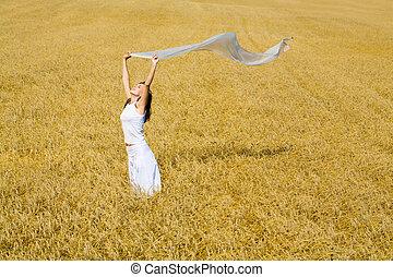 Enjoying woman - Portrait of enjoying woman with silk cloth...