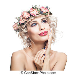 Enjoying woman with short blonde curly hair, makeup and flowers crown looking up isolated on white background. Perfect model girl portrait