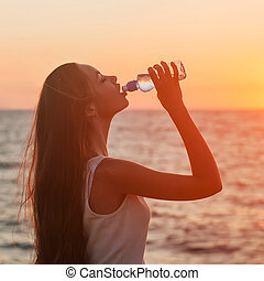 Enjoyment - free happy woman enjoying sunset. Asian Caucasian fe
