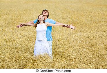 Enjoyment - Image of couple raising their hands and enjoying...