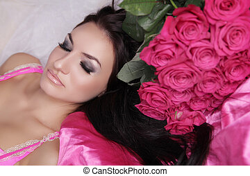 Enjoyment. Treatment. Beauty Model Woman Face. Beautiful Girl With Roses Flowers. Perfect Skin. Professional Make-up.