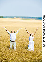 Enjoyment - View of happy people raising their hands ...