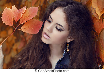 Enjoyment. Young happy smiling brunette woman over autumn...
