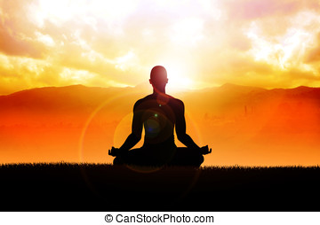 Enlightenment - Silhouette of a man figure meditating in the...