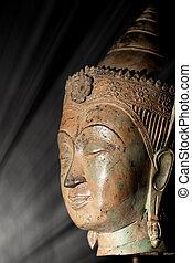 Enlightenment. Spiritual image of buddha head in a beam of light representing wisdom and awakening.