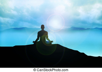 Enlightenment - Silhouette of a man figure meditating on the...