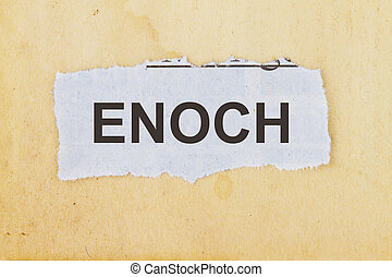 Enoch newspaper cutout in an old paper background.