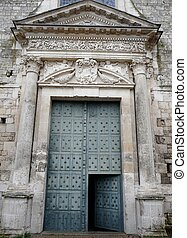 Enormous medieval church door with stone lintel